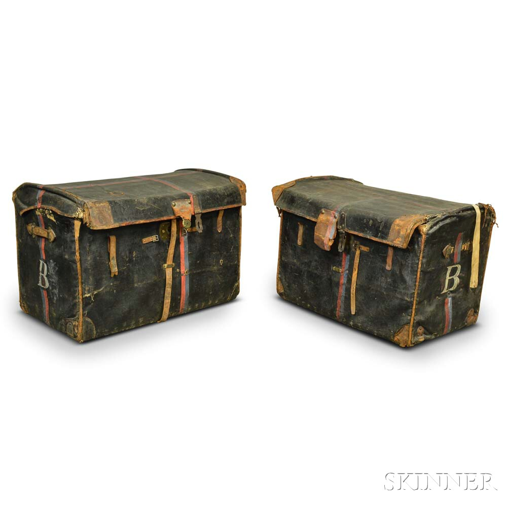 Two Leather-covered Dome-top Wicker Trunks.