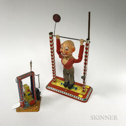 Two Lithographed Tin Swinging Toys