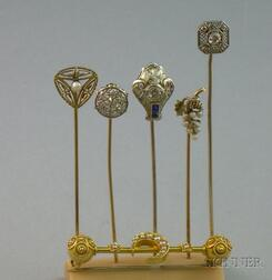 Five Art Deco Gold, Platinum, Diamond, and Seed Pearl Stickpins and a Victorian Gold and Seed Pearl Crescent Moon and Canatille Bar Pin