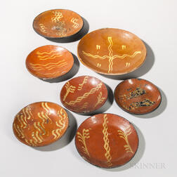 Seven Slip-decorated Redware Plates