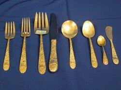 Fifty-four Piece Hallmark Sterling Silver Ribbon Rose Partial Flatware Set