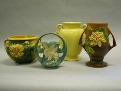 Roseville Pottery Water Lily Vase, Clematis Basket and Peony Jardiniere and a Monmouth Pottery Vase.