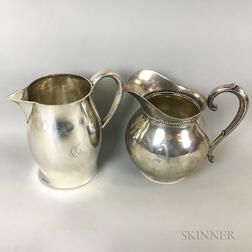 Two Sterling Silver Pitchers