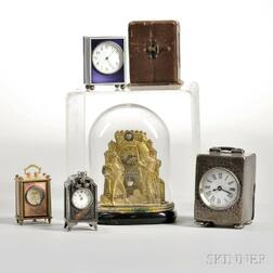 Five Miniature Enameled, Brass, and Silver Clocks