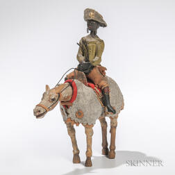 Carved and Painted Articulated Figure of a Black Man on a Horse