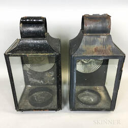 Two Glass and Black-painted Tin Barn Lanterns