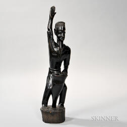 Carved Wooden Figure of a Man with a Drum.
