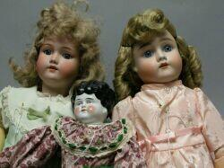 Two Bisque and One China Head Dolls