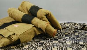 Three Olive Green and Black Hudson Bay Wool Point Blankets   and a Blue and White Jacquard Coverlet