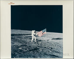 Apollo 12, Astronaut Pete Conrad with the American Flag, November 19, 1969.