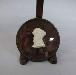 Framed Miniature Carved Ivory Profile of Henry VIII. together with several framed silhouettes.