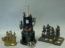 Pair of Cast Iron Old Ironsides Bookends, a Brass Sailing Ship Bookend and a Marv Painted Metal Robert Fulton Line Steam Engine Mod