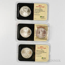 1988 and Three 2001 American Silver Eagles.     Estimate $80-100