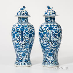 Pair of Blue and White Covered Vases