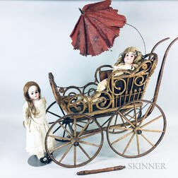 Two German Bisque Dolls and a Victorian Wicker Carriage