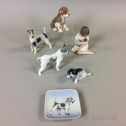 Four Royal Copenhagen Porcelain Dogs, a Mother and Child, and a Dog Dish