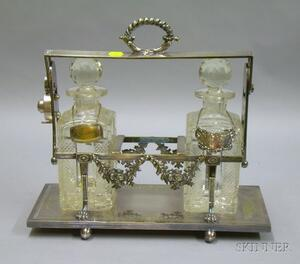 Silver Plated Tantalus with a Pair of Colorless Cut Glass Decanters