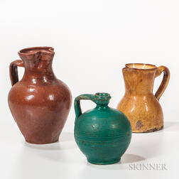 Two Redware Pitchers and a Green-glazed Jug