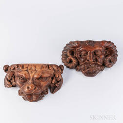 Pair of Carved Walnut Masks
