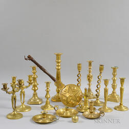 Fifteen Brass Candlesticks and Chambersticks and a Small Brass Bedwarmer.