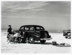 Marion Post Wolcott (American, 1910-1990)      Winter Visitors Picnicking on Running Board of Car on Beach, Sarasota, Florida