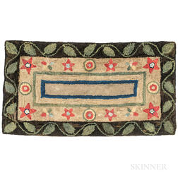 Hooked Rug with Star, Circle, and Vine Decoration