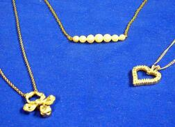 One Gold and Pearl and Two Gold and Diamond Pendant Necklaces.