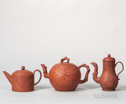 Three Red Stoneware Teapots and Covers