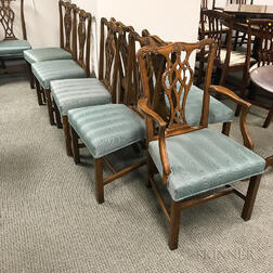 Set of Fourteen Chippendale-style Carved and Upholstered Mahogany Dining Chairs.     Estimate $800-1,200