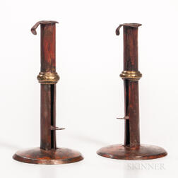 Two Red-painted Brass-banded Iron Hogscraper Candlesticks
