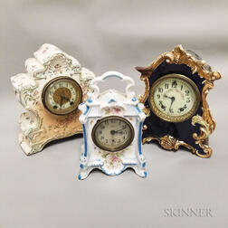 Three Small China Case Clocks