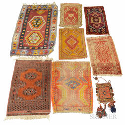 Eight Small Rugs
