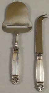 "Two Georg Jensen ""Acanthus"" Sterling Silver-handled Cheese Servers"