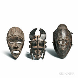 Three Carved Wood Masks