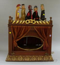 Early 20th Century Cherry and Gilt-gesso Puppet Theater Cabinet and Five Folk   Carved and Painted Wooden Hand Puppets