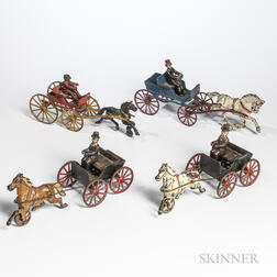 Four Cast Iron Cart and Driver Pull Toys