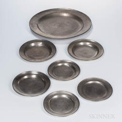Six American Pewter Plates and a Charger