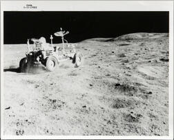 Apollo 16, Lunar Roving Vehicle in the Grand Prix Run, Driven by John Young, and a Photograph of a Lunar Boulder.