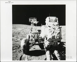 Apollo 16, On Moon, John Young Reaches for Tools.