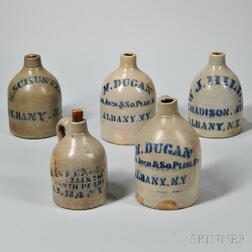 Five Stoneware Advertising Jugs