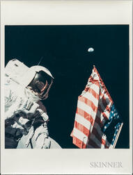 Apollo 17, Harrison Schmitt with the Earth above the American Flag, December 1972.