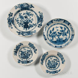 Four Floral-decorated Tin-glazed Earthenware Plates