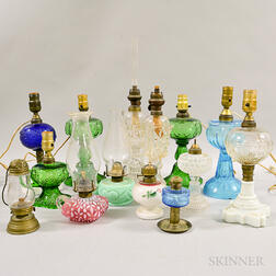 Fourteen Pressed Glass Oil Lamps