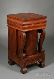 Empire Mahogany and Mahogany Veneer Lift-top Washstand with Revolving Medial Cabinet   over Drawer