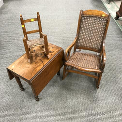 Miniature Federal-style Walnut Drop-leaf Table and Two Rocking Chairs.     Estimate $150-250