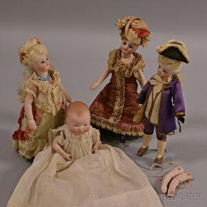 Four Small All Bisque Dolls