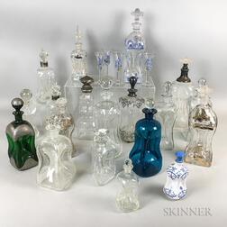Nineteen Mostly Colorless Glass Pinch Bottles