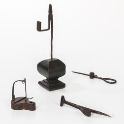 Four Wrought Iron Lighting Devices