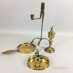 Two Brass Chambersticks, an Oil Lamp, and a Rush Light