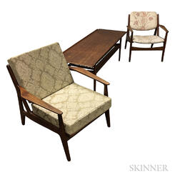 Two Lounge Chairs and a Coffee Table with Woven Shelf